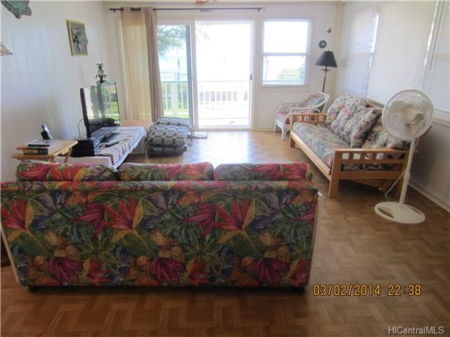 14-spacious-living-room-enters-out-to-the-lanai-and-ocean-views-this-could-also-be-considered-a-great-room-as-the-kitchen-is-open